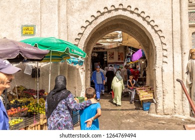 MARRAKESH, MOROCCO - SEPTEMBER 20, 2014: Marrakesh, Morocco - September 20, 2014: Entrance to the Djemaa el Fna market in old Medina, Marrakesh Morocco