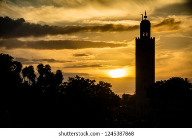 Marrakesh mosque in silhouette at sundown in Morocco