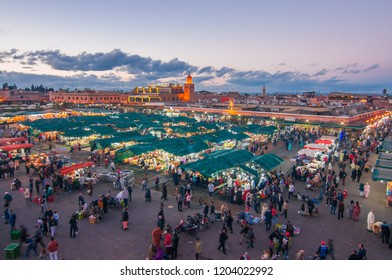 Marrakesh/Morocco - March 12, 2018: People at the Jemaa el Fna Square at sunset in Marrakesh, Morocco.