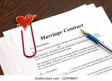Marriage contract with pen, close-up