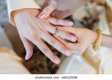 Marriage hands with rings,thai wedding story.