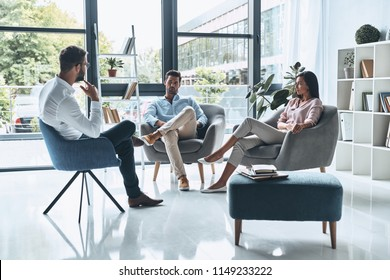 Marriage issues. Young married couple talking while sitting on the therapy session with psychologist