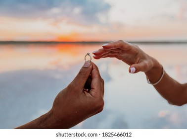 marriage proposal, putting rings on the finger