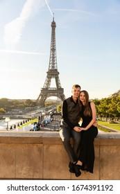 Marriage proposal, romantic date, honeaymoon in Paris, France. Portrait of happy couple near Eiffel tower
