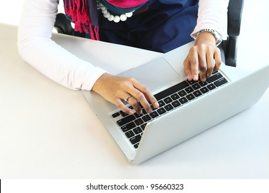Married businesswoman typing on laptop keyboard