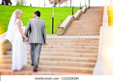 A married couple, bride and groom, walking around the city