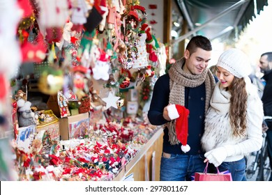 Married couple at Christmas market.