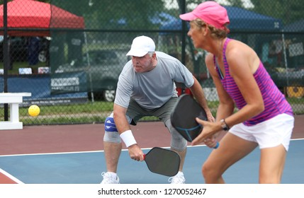 A married couple compete in the mixed doubles event of a seniors pickleball tournament