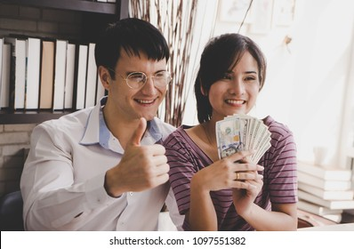 Married Couple counting money getting rich in family business
