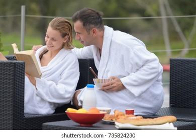 married couple enjoying breakfast on hotel terrace