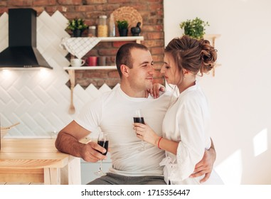 married couple at home drinking wine
