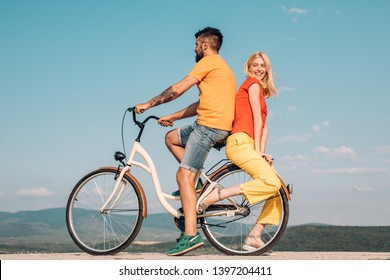 Married couple and sexual problems concept. Be Sensual. Couple In Love. Modern Trends. Summer love. Young lovers. Active couples. Young hippie couple on sky blue background.