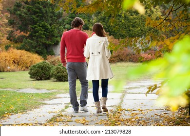Married couple walking down the alley park