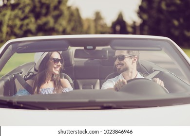Married family, friendship, trip, relax, chill, escape, speed ride, valentine, honeymoon. Closeup of well dressed brunet driver in eyewear, femenine gorgeous cute brunette lady look at each other