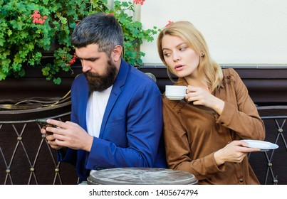 Married lovely couple relaxing together. Couple cafe terrace drink coffee. Couple in love sit cafe terrace enjoy coffee. Man secret messaging cheating on wife. Cheat and betrayal. Family weekend.
