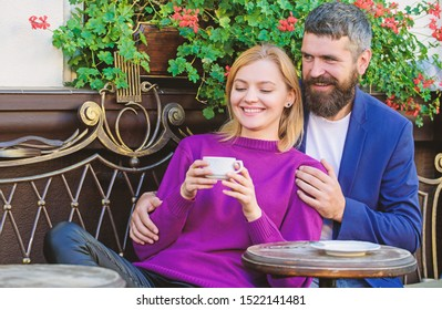 Married lovely couple relaxing together. Travel and vacation. Explore cafe and public places. Couple cuddling cafe terrace. Couple in love sit cafe terrace enjoy coffee. Pleasant family weekend.