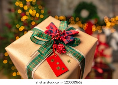 Marry Christmas and happy New Year gifts boxe with craft paper green tipe and red bow.