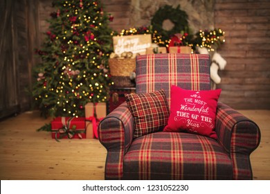 Marry Christmas and happy New Year celebration. Family living room with armchair red cloth design festive home decor.