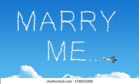 marry me airplane smoke on blue sky skywriting