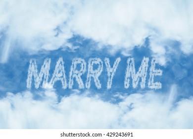 Marry me cloud message on blue sky , Soft focus background