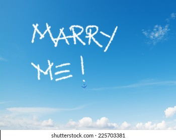"""""""marry me!"""" written in the sky with contrails left by airplane"""