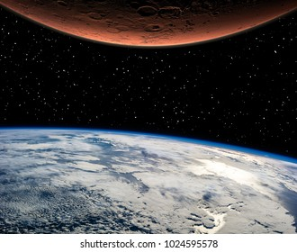 Mars and earth. Distance between them. Space for text. The elements of this image furnished by NASA.