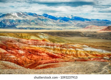 Mars mountains, the name of colored mountain protrusions in the mountains of Kyzyl-Chin. Altai, Russia. A delightful landscape of unreal beauty.