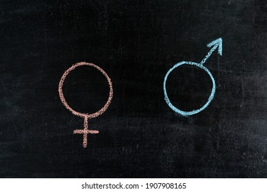 Mars and Venus symbol on chalk board, woman and man