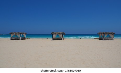 Marsa Matruh, Egypt. Elegant gazebo on the beach. Amazing sea with tropical blue, turquoise and green colors. Relaxing context. Nobody on the beach. Fabulous holidays. Mediterranean Sea. North Africa