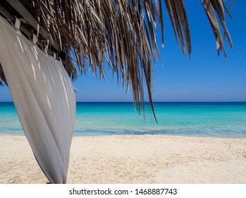 Marsa Matruh, Egypt. The sandy beach and the amazing sea with tropical blue, turquoise and green colors. Relaxing context. Fabulous holidays. Mediterranean Sea. North Africa. Clean and pristine sea