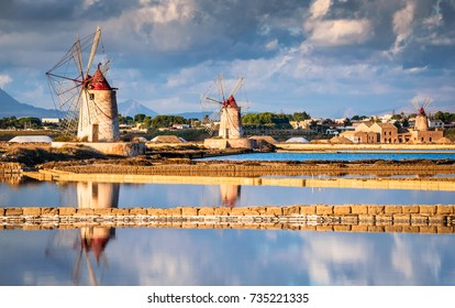 Marsala, Italy. Stagnone Lagoon with vintage windmills and saltwork, Trapani province, Sicily.