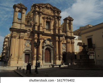 Marsala – Purgatory Church decorated facade in a square with a fountain
