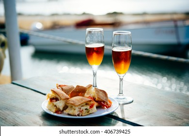 Marsala wine and typical Sicilian snacks are served for aperitivo in Marsala, Sicily, Italy.