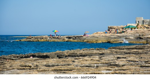 MARSASCALA, MALTA - 25 JUNE, 2017: A rocky beach in Malta