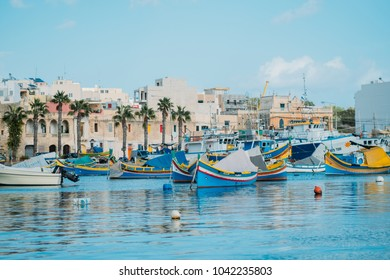Marsaskala, Malta - 12.02.2018 - Wide view of the port in Marsaskala with vivid colored boats in the background
