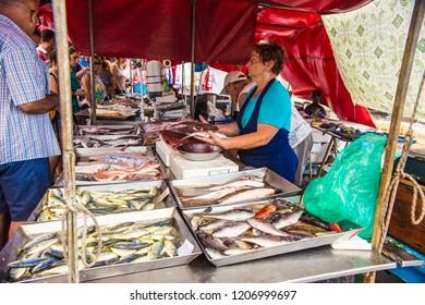 Marsaxlokk, Malta - September 2018: Fish market at Marsaxlokk. People selling fresh fish on the fish market in Marsaxlokk, Malta
