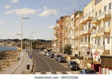 MARSAXLOKK, MALTZ - NOV 30, 2018 - Apartment buildings along the waterfront of Marsaxlokk, Malta