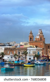 Marsaxlokk Parish Church and luzzu boats, Malta