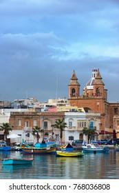 Marsaxlokk Parish Church and luzzu boats, Malta