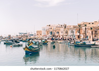 Marsaxlokk/Malta - May 1, 2018: A view on the typical Maltese harbor with their traditional boats - luzzu