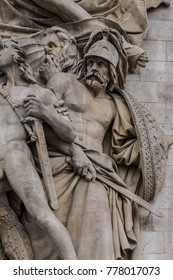 The Marseillais volunteers departing sculpted in the Arc de Triomphe. Arc de Triomphe de l'Etoile on Charles de Gaulle Place is one of the most famous monuments in Paris. France.