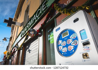 Marseillan, France - December 30, 2018: condom distributor in front of a pharmacy in the city center on a winter day