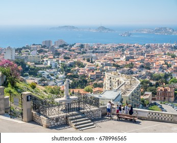 MARSEILLE - APRIL 11 : Cityscape viewpoint of Marseille, from Notre-Dame de la Guard catholic church with unrecognized tourists, under clear blue sky in France, on April 11, 2017.
