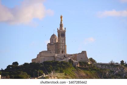 Marseille: Basilique Notre-Dame de la Garde, la Bonne Mère. The Basilica of Our Lady of the Guard, religious famous monument. The scenic stone bell tower of Notre Dame de la Garde Basilica.