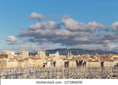 Marseille, Provence-Alpes-Côte d'Azur, FRANCE, November/26/2018. View of the city of Marseille and its old port (French: Vieux-Port de Marseille), seen from the Pharo park.