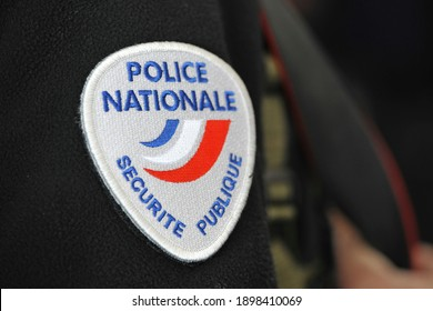 Marseille, France - 01 19 2021: Close-up of the National Police symbol sewn on the sleeve of a policeman during a control operation in Marseille.