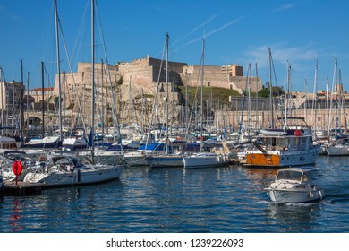Marseille. France. 06.14.12. Marseille Castle above the yachts in the harbor of the Port of Marseille on the Cote d'Azur in the South of France.