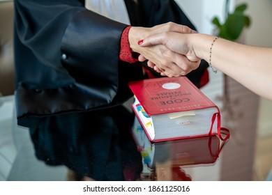 Marseille, France - 11-23-2020:  lawyer shakes hands with his client