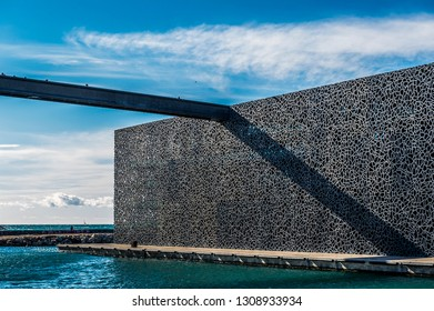 MARSEILLE. FRANCE. BOUCHES-DU-RHÔNE (13). 03/05/2016.  ON THE MOLE J4, THE MUCEM (MUSEUM OF CIVILIZATIONS OF EUROPE AND THE MEDITERRANEAN) BY ARCHITECT RUDY RICCIOTTI