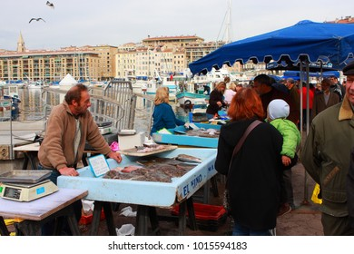 Marseille, France - 25 February 2010.: Fish market place on Marseille and shop assistant.